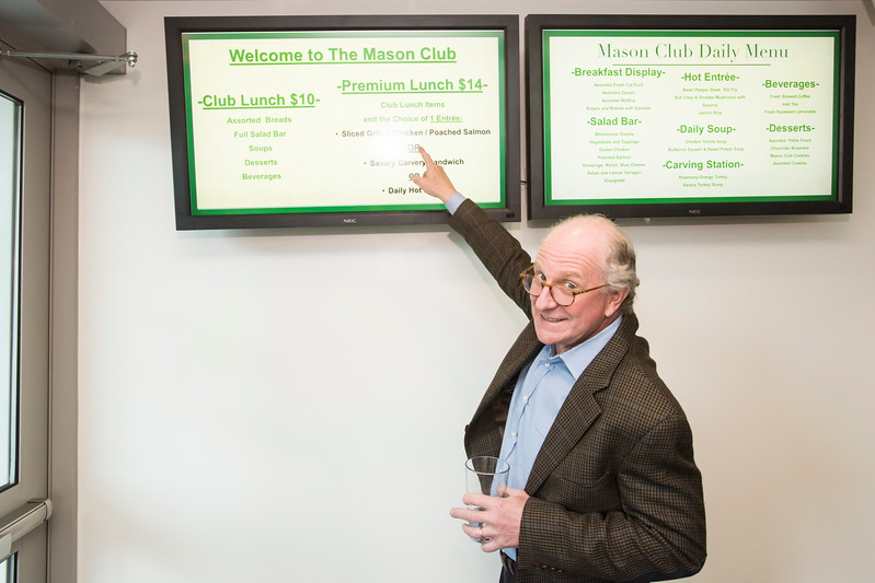 Steven Pearlstein points to the menu of The Mason Club, a new faculty and staff dining room and lounge opens in Fairfax Campus.  Photo by:  Ron Aira/Creative Services/George Mason University