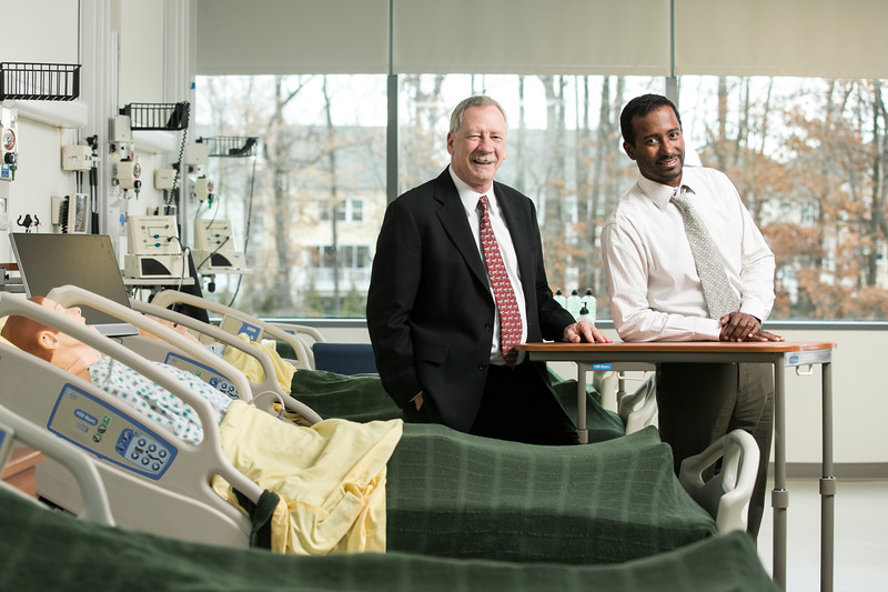 R. Kevin Mallinson (left), assistant dean of the School of Nursing, is back from Oman.  Pictured here is PhD student Abdullah Al Mahrouqi.  When he completes his PhD program at Mason, Mahroqui, who is also a college professor, will become the fifth Mason graduate to lead an Omani nursing school. Photo by:  Ron Aira/Creative Services/George Mason University