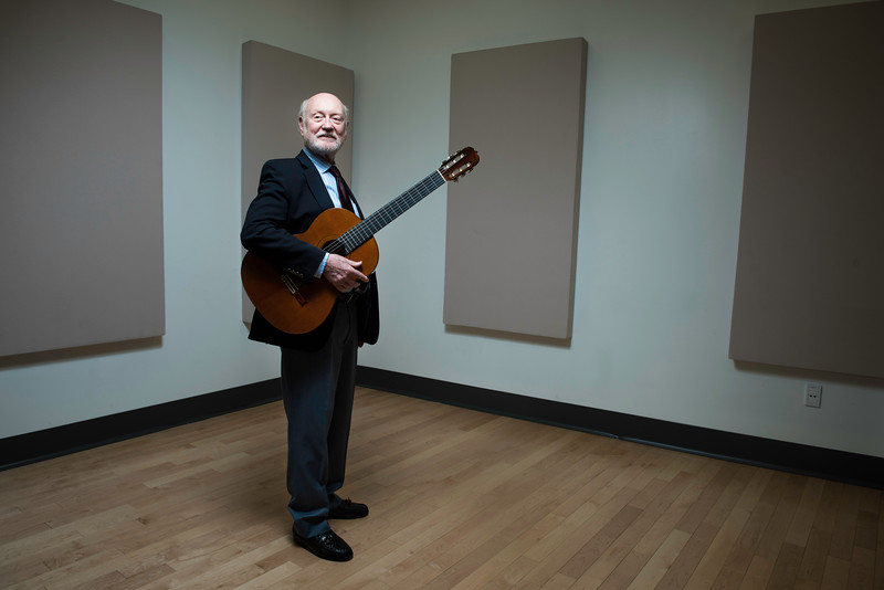"Larry Snitzler, 71, who has taught classical guitar at George Mason University for 41 years as an adjunct professor, is retiring at the end of this semester. He and his wife, Soledad, will live in her native, Santiago, Chile, where he will complete his book on Spanish composer Joaquin Matas, write music and continue playing in the United States and Europe. Said Linda Monson, managing director of George Mason's School of Music: ""He will be deeply missed.""  Photo by:  Ron Aira/Creative Services/George Mason University"