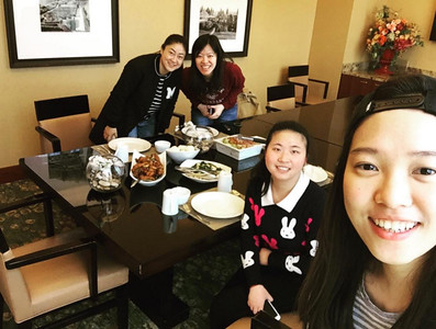 From left to right: Hao Yue Xi, Yu-Ping Lin, Ya Peng, and Pin-Erh Chen (in the foreground). INTO students enjoy a Taiwanese salt and pepper chicken recipe, courtesy of Pin-Erh Chen, that was made at The Globe.  Handout Instagram account of Pin-Erh Chen