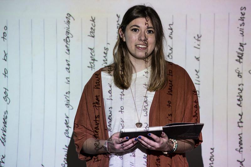 Carmine Gothard, a freshman at George Mason, showcases her poetry.  Bethany Camp/Creative Services/George Mason University