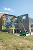 MARICAMA's mural is installed in preparation for Mural Day on April 7th. MARICAMA's mural is the first professional artist's mural to be displayed on the GMU campus for Mural Day. (Bethany Camp/Creative Services/George Mason University)