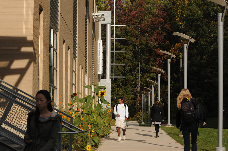 Students walking to class in front of the Art and Design building