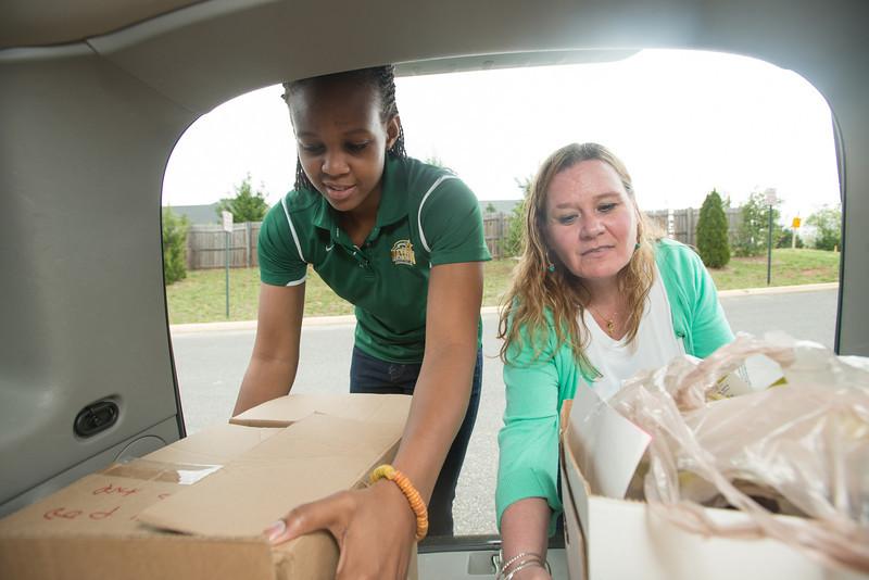 Women's Shelter donations with Joy Tharrington