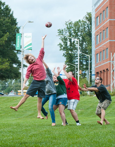 students play football - Fairfax Campus