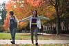 Students enjoy the fall leaves changing colors during autumn at Fairfax campus. Photo by Alexis Glenn/Creative Services/George Mason University