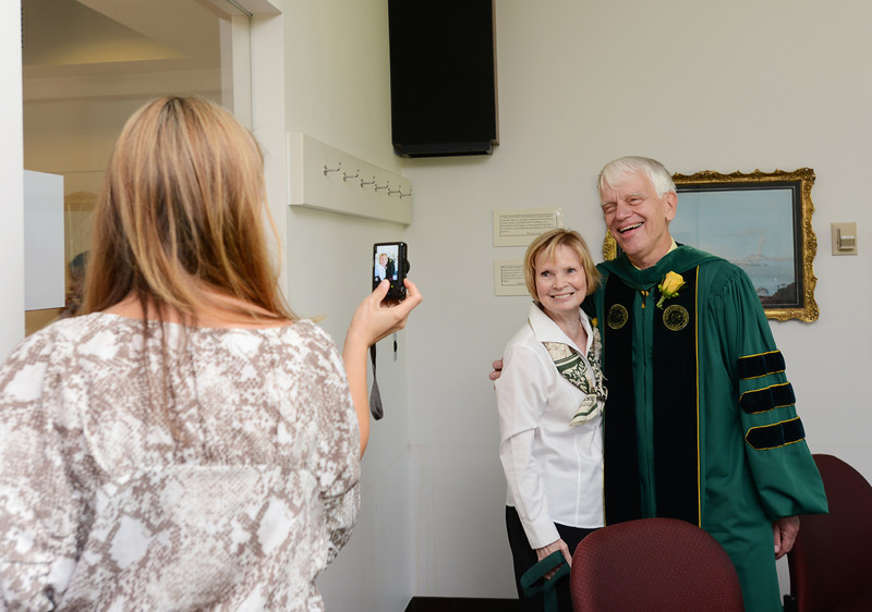 Alan and Sally Merten pose together after the Commencement ceremony. Photo by Evan Cantwell/Creative Services/George Mason University