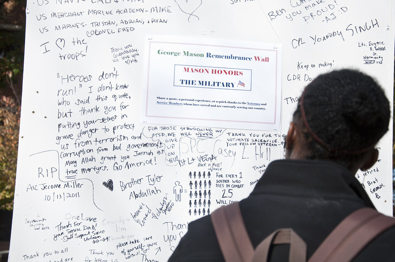 Students read messages of support wrote by fellow students, staff and faculty members on the Remembrance Wall