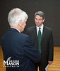 Attorney General Ken Cuccinelli speaks to Dr. Alan Merten before presentations by Mason Game Design students in Dewberry Hall at Fairfax Campus. The students created interactive and educational games aimed at teaching about the risks of joining gangs. Photo by Alexis Glenn/Creative Services/George Mason University