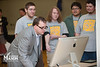 Assistant Director of the Computer Game Design Program Seth Hudson plays a game created by Mason Game Design students in Dewberry Hall at Fairfax Campus. The students created interactive and educational games aimed at teaching about the risks of joining gangs. Photo by Alexis Glenn/Creative Services/George Mason University