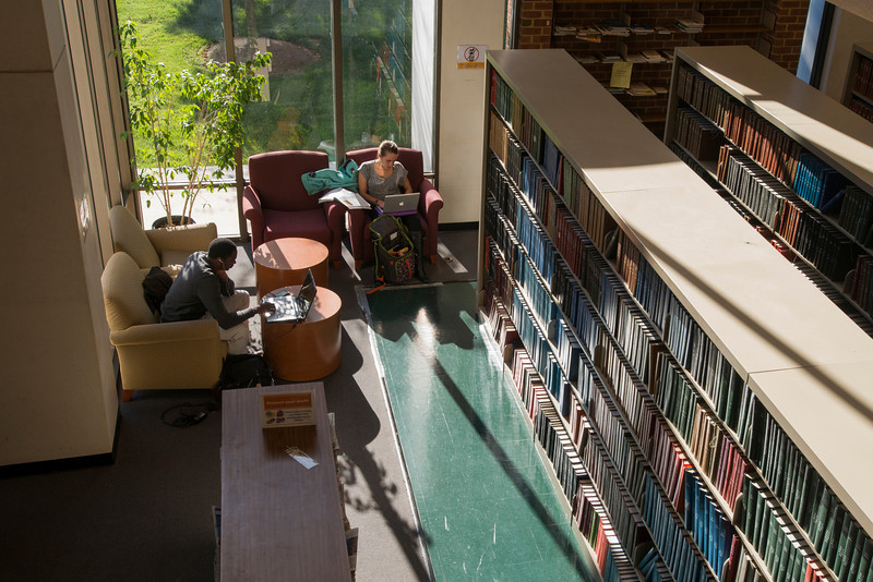 Students work on laptops inside Fenwick Library. Photo by Alexis Glenn/Creative Services/George Mason University