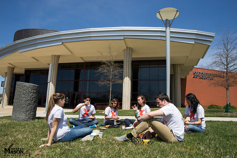 TEDx student volunteers have lunch outside the Hylton Performing Arts Center during the 3rd annual TEDx conference. Photo by Craig Bisacre/Creative Services/George Mason University
