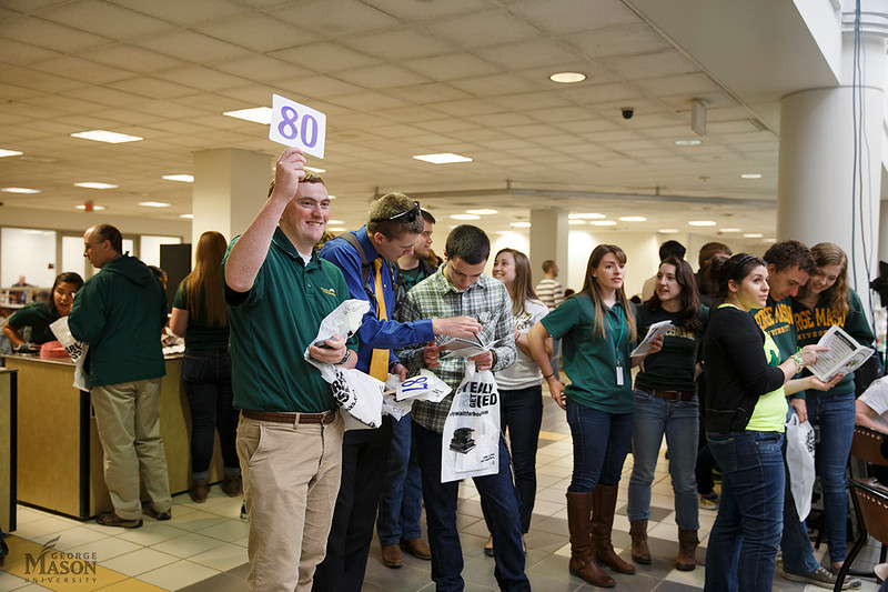 The Mason Community participates in the annual GBAY student scholarship auction run by the George Mason University Student Ambassadors. Photo by Craig Bisacre/Creative Services/George Mason University