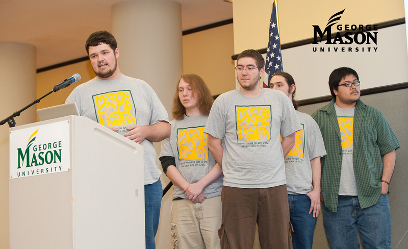 """Team members Stephen Berrigan, Steven Fernandez, Devin Gibson, John Murphy, and Damiel Paquette speak about their game """"New Kid on the Block"""" at Mason Game Design student presentations in Dewberry Hall at Fairfax Campus. The students created interactive and educational games aimed at teaching about the risks of joining gangs. Photo by Alexis Glenn/Creative Services/George Mason University"""