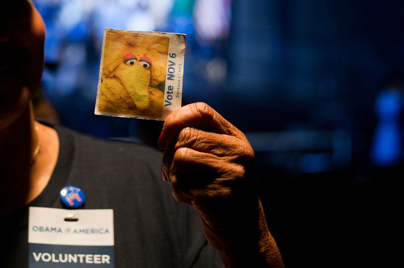 "Supports wear ""Big Bird"" pins from Sesame Street, during President Barack Obama campaign event at George Mason Univ., Friday, Oct. 5, 2012, in Fairfax, Va. The use of ""Big Bird"" comes days after, Republican presidential candidate former, Massachusetts Gov. Mitt Romney referenced to the Sesame Street character during the Presidential Debates this past Wednesday. (Craig Bisacre/Creative Services/George Mason University) George Mason University all rights reserved"