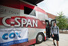 A student de-boards after touring the C-SPAN Civic Bus at Fairfax campus. The bus is a space for students, faculty and citizens to discuss media, public affairs and C-SPAN programming. Photo by Alexis Glenn/Creative Services/George Mason University