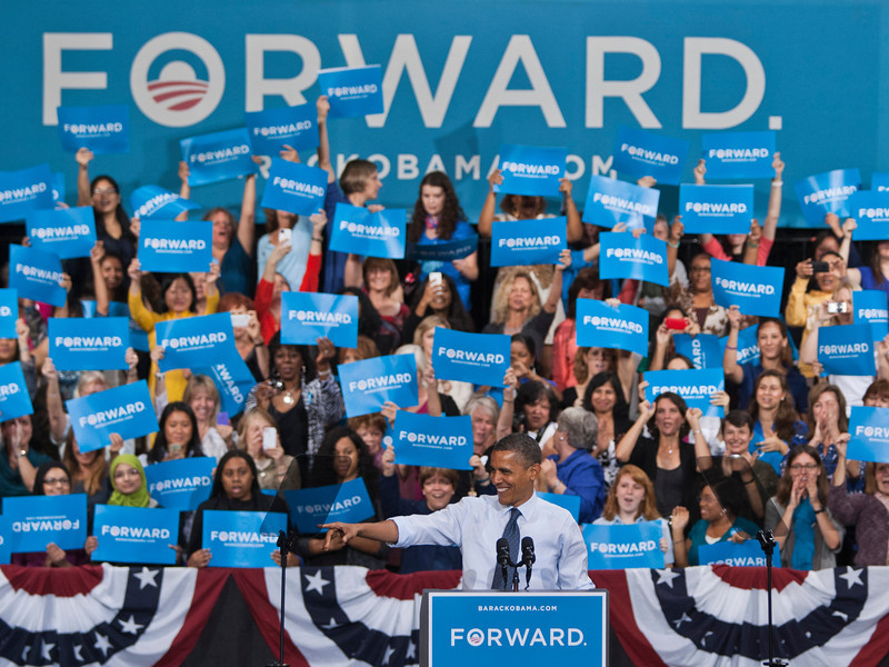 President Barack Obama points and waves to supporters on stage during a campaign event at George Mason Univ., Friday, Oct. 5, 2012, in Fairfax, Va. (Craig Bisacre/Creative Services/George Mason University) George Mason University all rights reserved