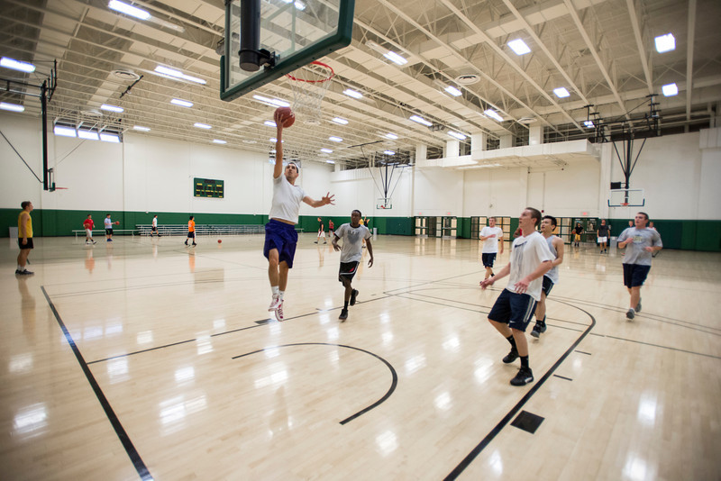 Students play pickup basketball at the Recreation and Athletic Complex at Fairfax Campus. Photo by Alexis Glenn/Creative Services/George Mason University