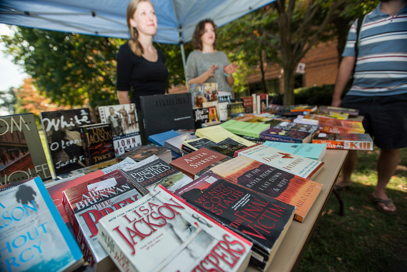 Student staff of Volition Magazine, Mason's undergraduate art and literary journal, host a book swap during Fall for the Book week at Fairfax campus. Photo by Alexis Glenn/Creative Services/George Mason University