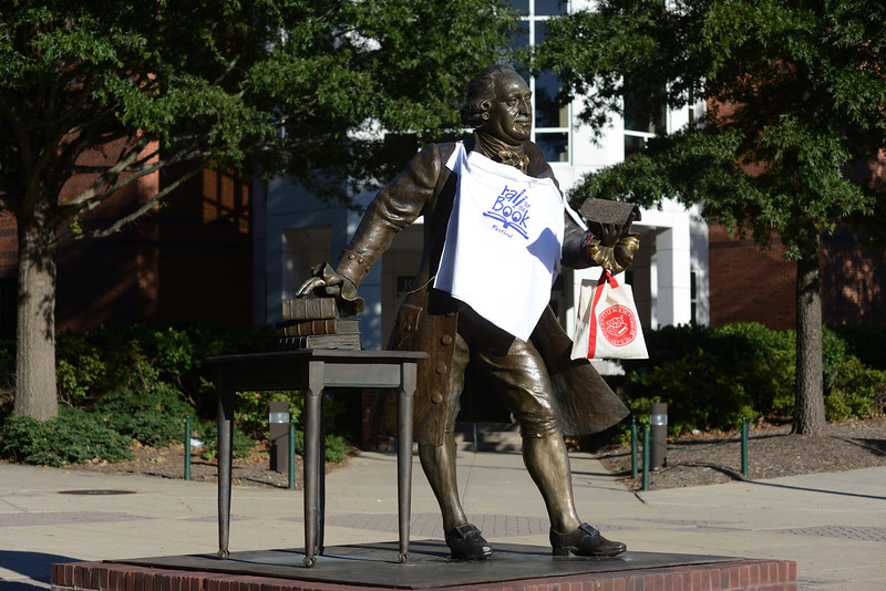 George Mason statue with Fall for the Book tshirt. Photo by Evan Cantwell/Creative Services/George Mason University