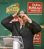 Brad Edwards puts on a Mason Patriot hat while being introduced as the new Mason Athletic Director during a press conference at the Mason Inn. Photo by Craig Bisacre/Creative Services/George Mason University