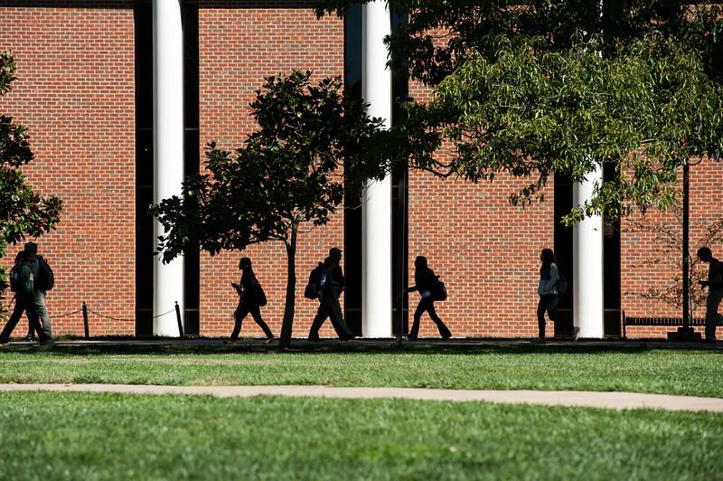 Students walk near Fenwick Library at Fairfax campus. Photo by Alexis Glenn/Creative Services/George Mason University