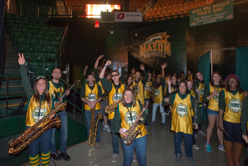 Members of the Green Machine cheer at Mason Madness at the Patriot Center. Photo by Alexis Glenn/Creative Services/George Mason University