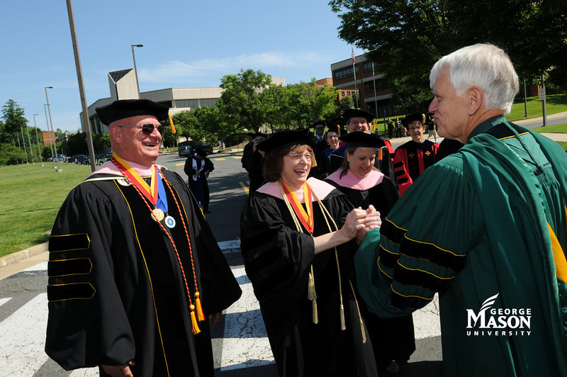 President Alan Merten greets faculty during the academic procession. Photo by Evan Cantwell/Creative Services/George Mason University