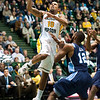 Guard Sherrod Wright (10) goes for a layup against ODU during the Mason Homecoming 2012 basketball game at the Patriot Center, Fairfax Campus. Photo by Alexis Glenn/Creative Services/George Mason University