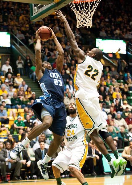 Forward Mike Morrison (22) blocks a shot by ODU during the Mason Homecoming 2012 basketball game at the Patriot Center, Fairfax Campus. Photo by Alexis Glenn/Creative Services/George Mason University