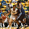 Guard Sherrod Wright drives the ball past a ODU player during the Mason Homecoming 2012 basketball game at the Patriot Center, Fairfax Campus. Photo by Alexis Glenn/Creative Services/George Mason University