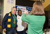 Mason alumnus and Olympic gold medalist David Verburg, center, gets his photo with Darrell Green, Associate Athletics Director, Special Assistant to the Athletic Director, by President Ángel Cabrera during the men's basketball game against La Salle on Sat. Feb. 4, 2016.  Photo by Bethany Camp/Creative Services/George Mason University