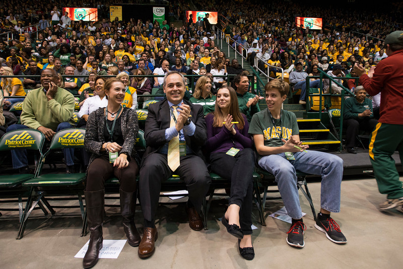 The Cabrera family (L to R) Beth Cabrera, Dr. Ángel Cabrera, and their children Emily and Alex attend Mason Madness at the Patriot Center. Photo by Alexis Glenn/Creative Services/George Mason University