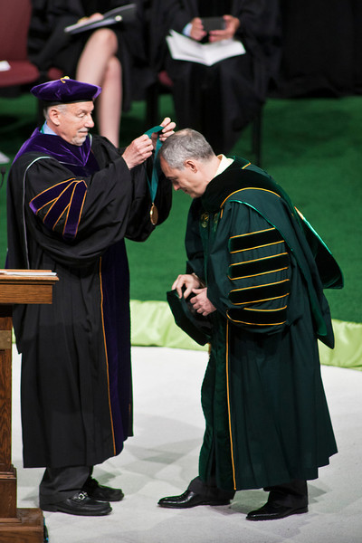 Board of Visitors Rector C. Daniel Clemente presents President Ángel Cabrera with the Presidential Medallion at the Installation Ceremony of the Inauguration of Ángel Cabrera at the Patriot Center. Photo by Craig Bisacre/Creative Services/George Mason University