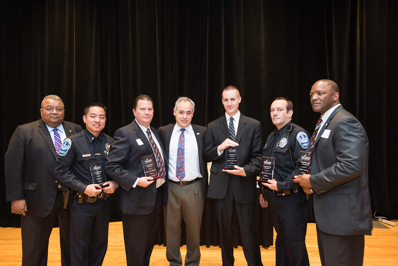 Carl Rowan Jr., Chief of Police, Police and Public Safety left, and President Ángel Cabrera, center, pose with Presidential Citation award recipients, from left to right, Thuan Ly, Administrative Services, Special Events, Police and Public Safety, Thomas Bacigalupi, Sergeant, Police and Public Safety, Brian Morrison, Police Officer, Police and Public Safety, Edward T. Gannon Sr., Master Police Officer, Police and Public Safety, Kim Taylor, Detective, Police and Public Safety during the 2016 Outstanding Achievement Awards.  Photo by Ron Aira/Creative Services/George Mason University
