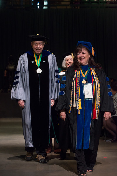Janette Muir, Associate Provost, walking in the processional with former president George Johnson. Photo by Evan Cantwell/Creative Services/George Mason University