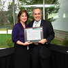 Donna Fulton of the National Center for Biodefense and Infectious Diseases is awarded Employee of the Month by President Cabrera.