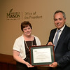 Heather Madnick, Employee of the Month, with President Cabrera.