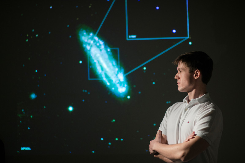 Nathan Secrest, PhD student in physics discovers a black hole in spiral galaxy NGC 4178. Photo by Evan Cantwell/George Mason University