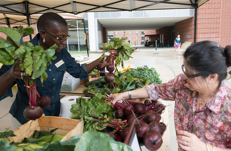 Registered Dietician Lois Durant visits the Southside Farmers' Market. The produce, sourced locally from regional farms, is also used at Mason's on-campus dining facilities. Photo by Alexis Glenn/Creative Services/George Mason University