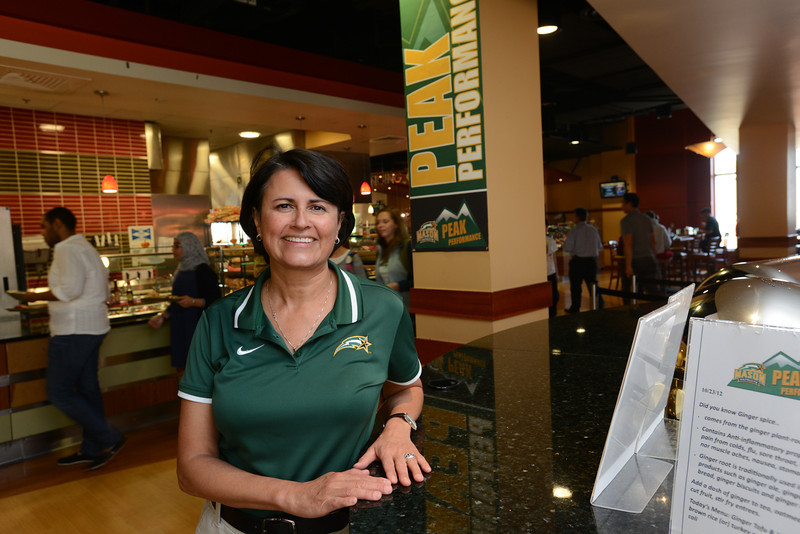 Theresa Logan, Mason athletics dietician, posing in Southside.