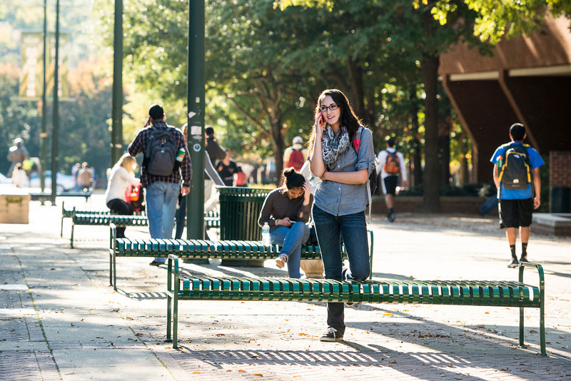 A student uses her cell phone at Fairfax campus. Photo by Alexis Glenn/Creative Services/George Mason University