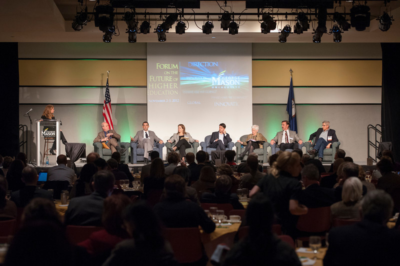 Panelists (L to R) Alexander McCormick, Anthony Pellegrino, Kelly Schrum, Jeff Selingo, Jeanne Narum, James Trefil, and Mills Kelly speak at Forum on the Future of Higher Education in Dewberry Hall at Fairfax campus. Photo by Alexis Glenn/Creative Services/George Mason University
