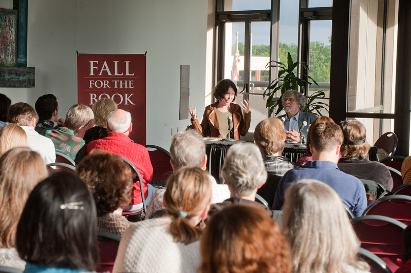 Novelists Alan Cheuse (R) and Allegra Goodman sign copies of their books the 2011 Fall for the Book series at the Center for the Arts, Fairfax Campus