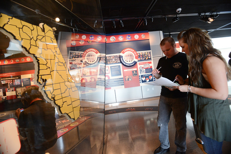 "Janette Muir's, associate professor in New Century College, class studying presidential elections tours the  Newseum's election-year exhibit, ""Every Four Years: Presidential Campaigns and the Press,"" exploring how media coverage of presidential campaigns has evolved from William McKinley's 1896 front porch campaign to Barack Obama's 2008 Internet campaign. Photo by Evan Cantwell/Creative Services/George Mason University"