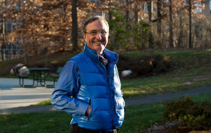 Thomas E. Lovejoy, Professor of Environmental Science and Policy and Public and International Affairs, poses for a portrait outside of Research Hall on Fairfax Campus. Photo by Alexis Glenn, Creative Services, George Mason University