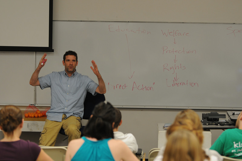 Paul Gorski, an assistant professor of integrated studies in New Century College, teaches students about animal rights.