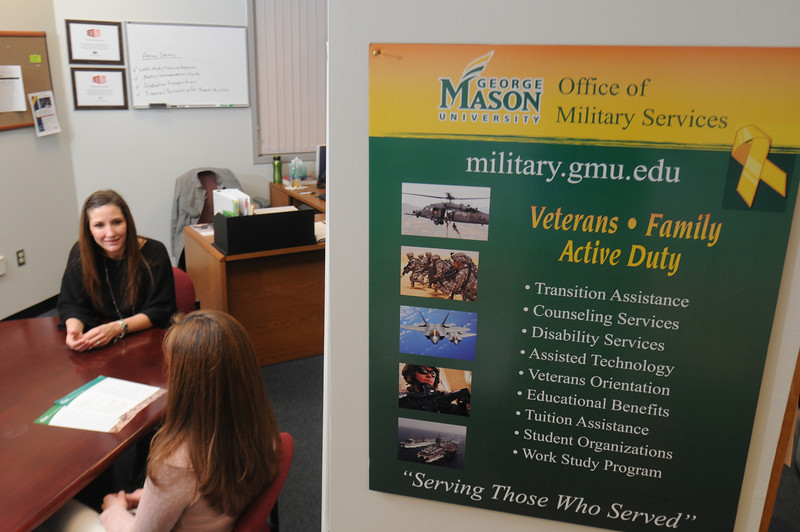 Military Services director  Jennifer Connors meets with graduate student Terri Hines to go over some of the programs available to her. Connors comes to Mason after a 14-year Air Force career.