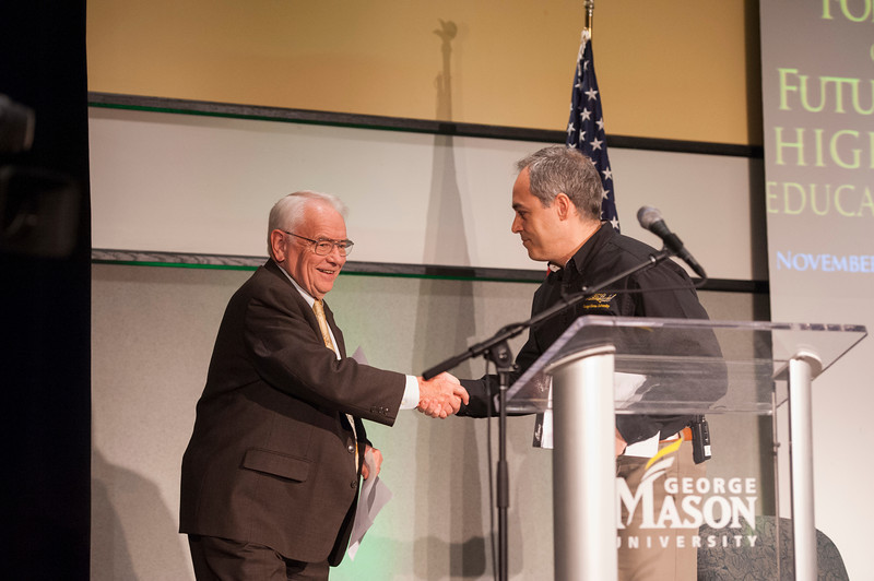 President Ángel Cabera (R) welcomes Provost Peter Stearns at the Forum on the Future of Higher Education in Dewberry Hall at Fairfax campus. Photo by Alexis Glenn/Creative Services/George Mason University