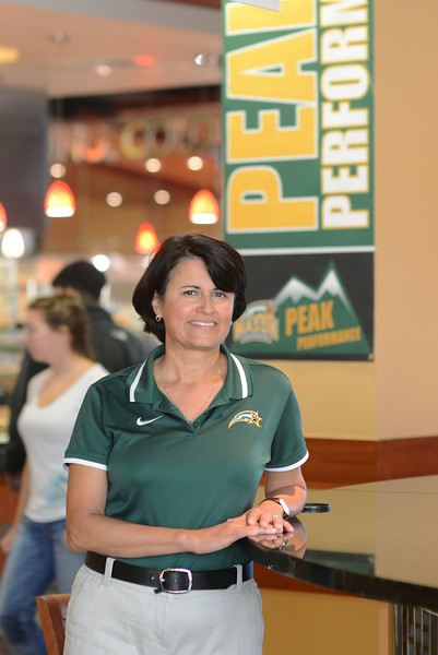 Theresa Logan, Mason athletics dietician, posing in Southside.